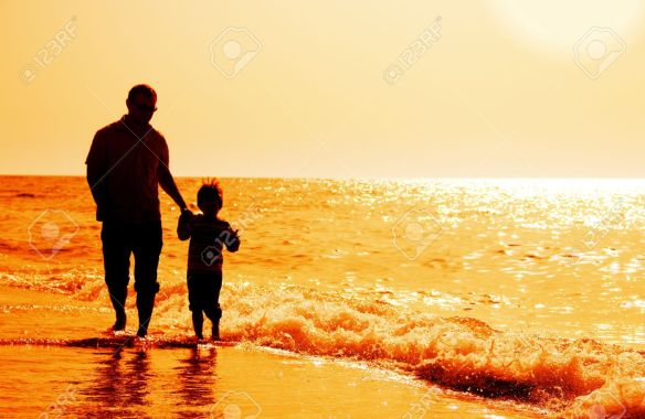 13396071-silhouettes-of-father-and-son-on-sunset-sea-background
