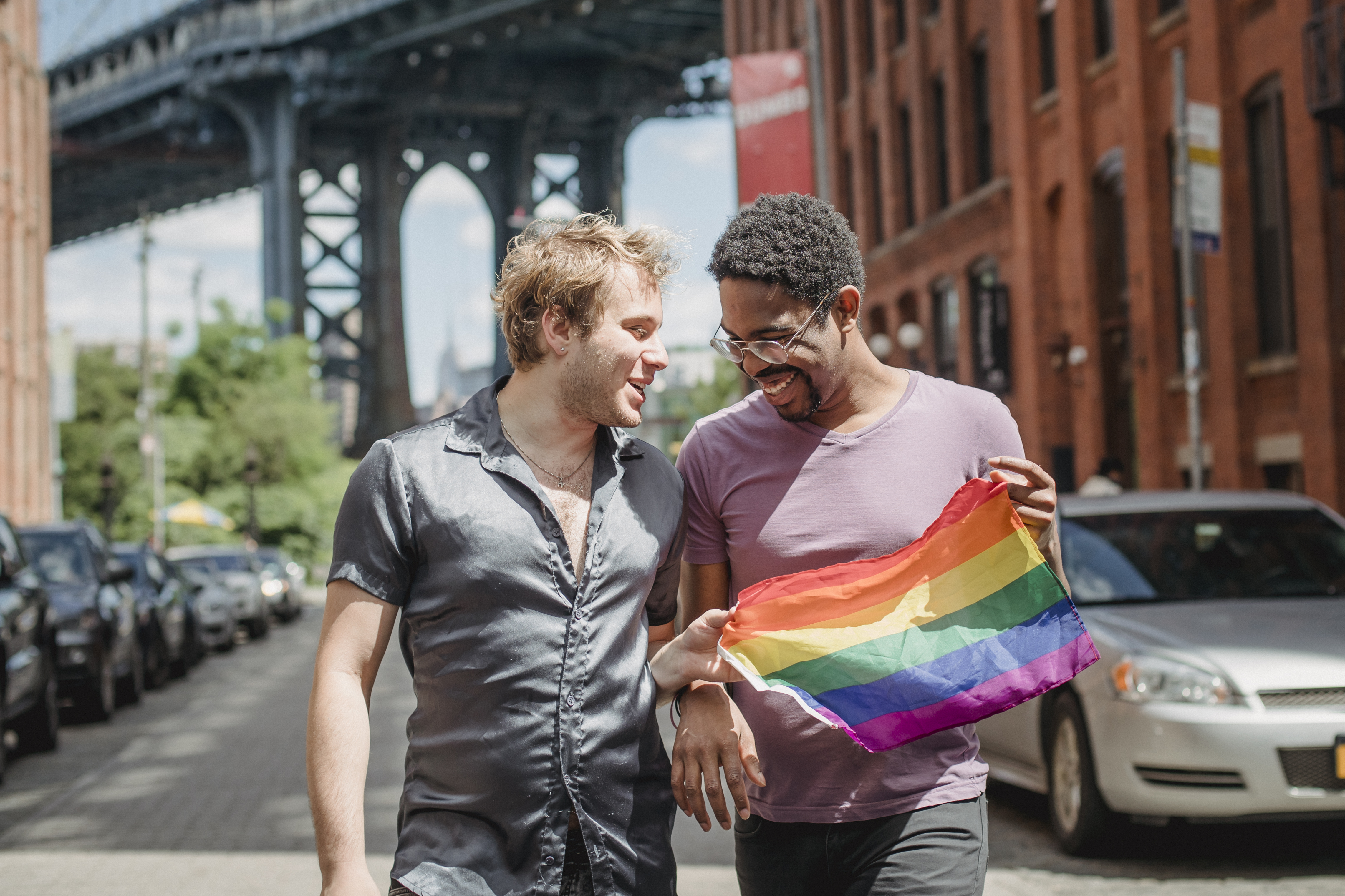 happy-couple-holding-a-lgbt-flag-4658052